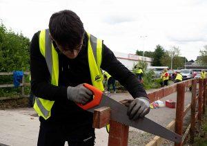 Man repairing fence