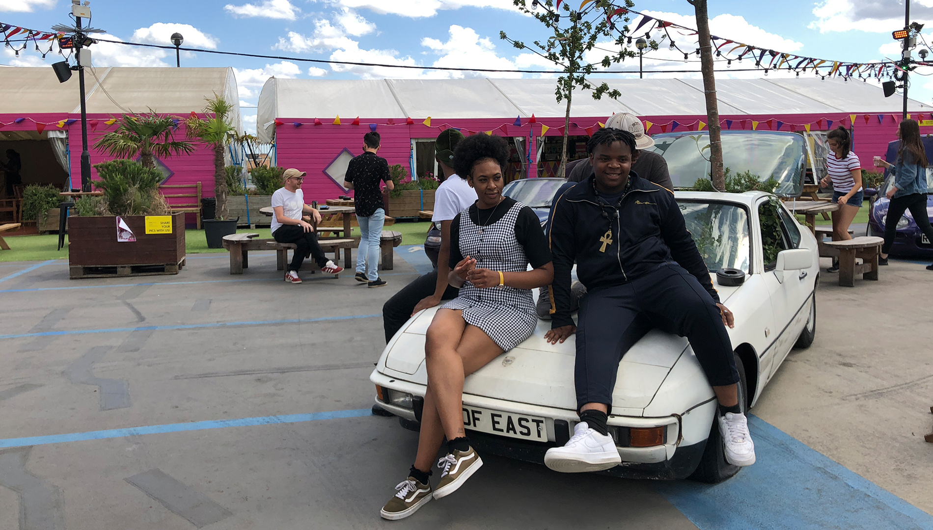 Young people from Groundwork's Peckham Studios music project sitting on car at Roof East