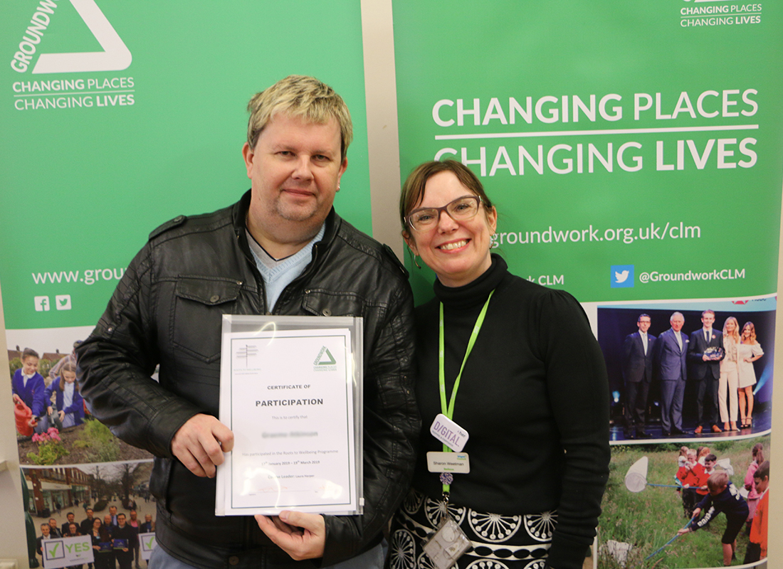 Roots To Wellbeing participant receives completion certificate
