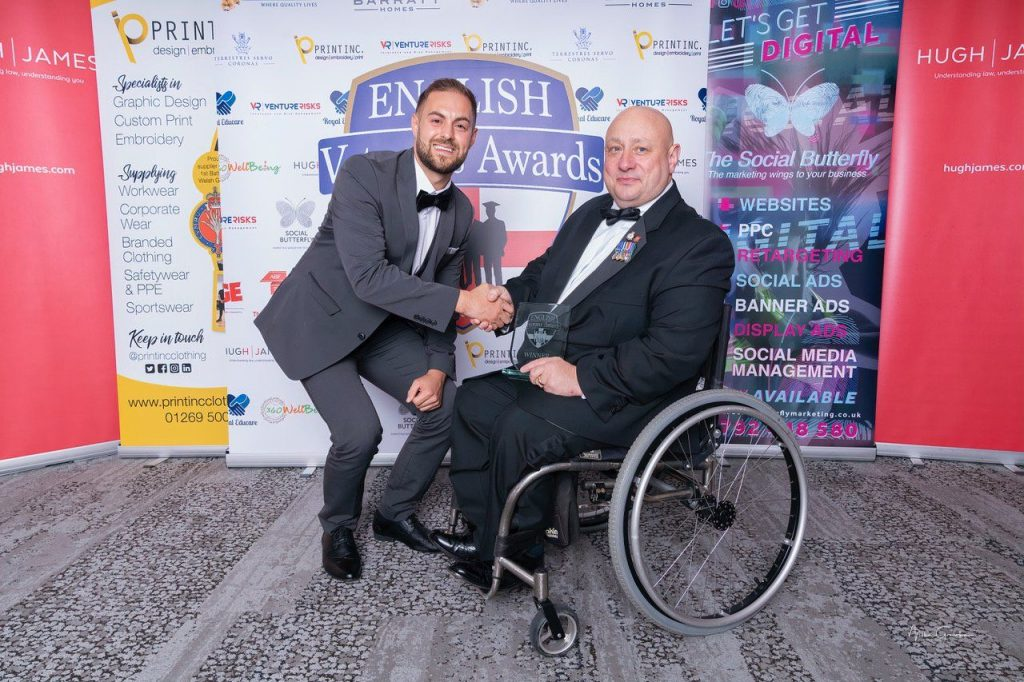 Terry Morley receiving award