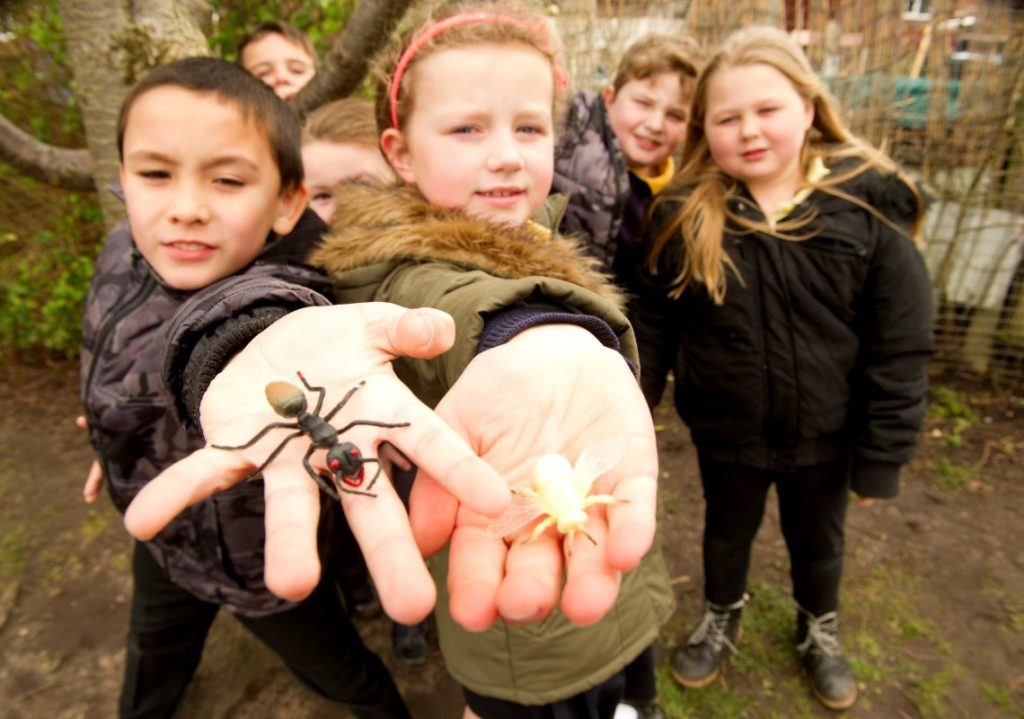 Group of children with bugs