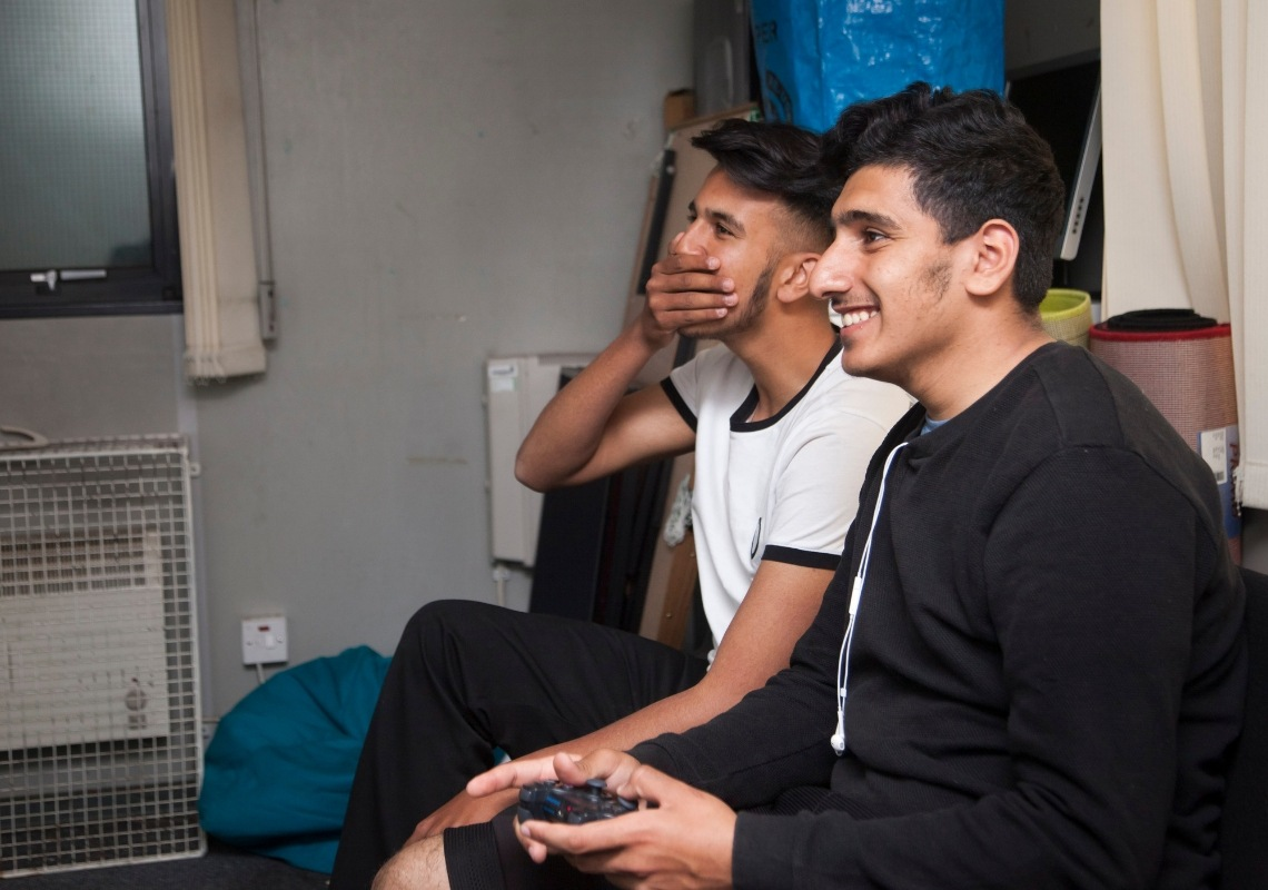 Two boys at youth club playing games