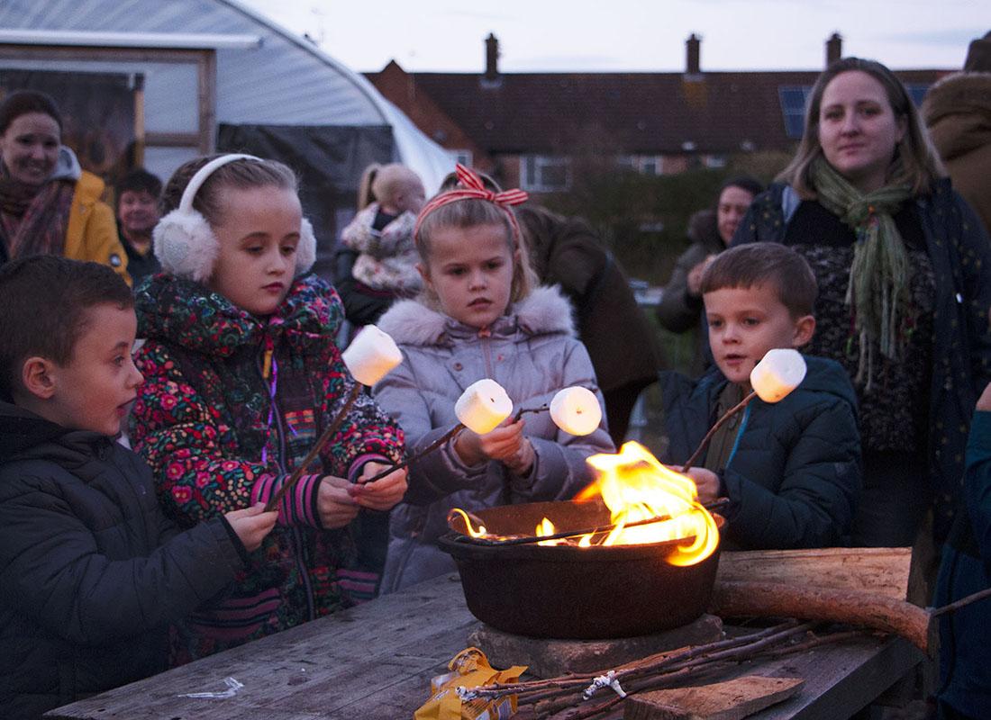 Children toasting marshamallows