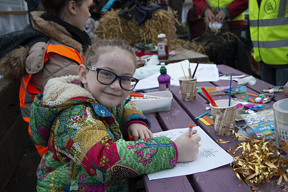 Young girl colouring in a drawing