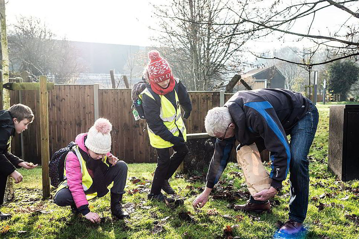 local people planting bulbs in Northwich town centre