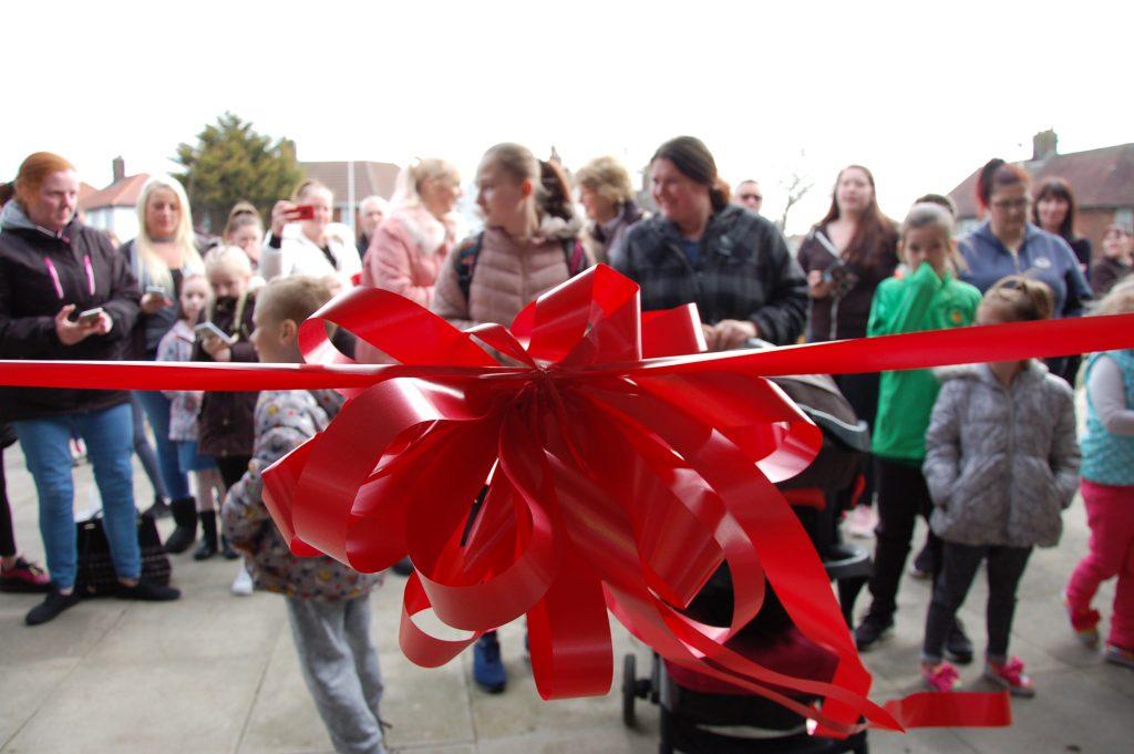 Red ribbon at grand opening
