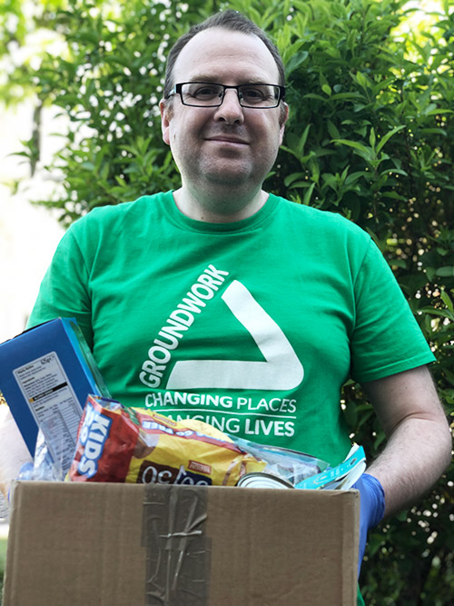 Groundwork employee with food parcel