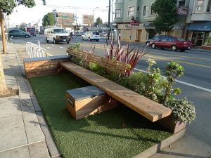 Wooden bench parklet in city