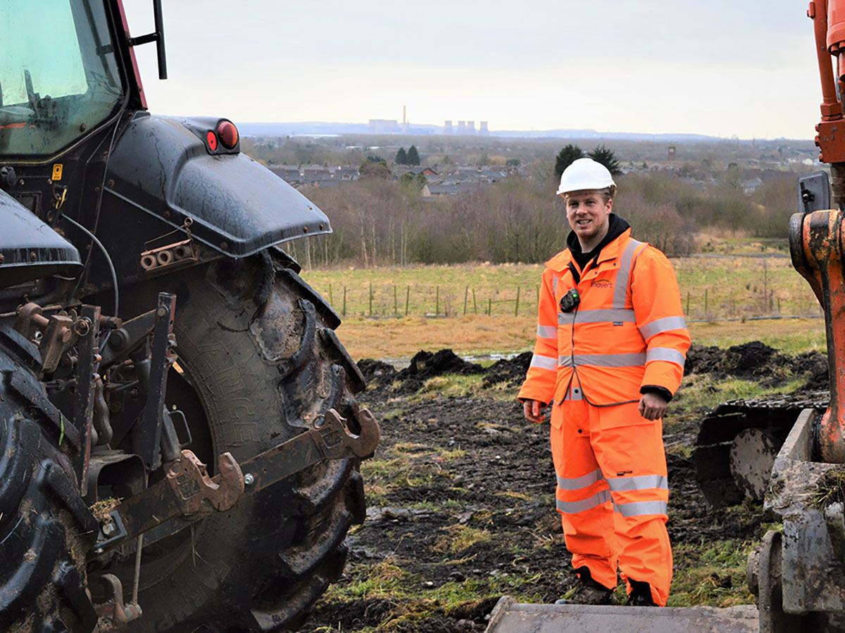 Scott working outdoors with tractors