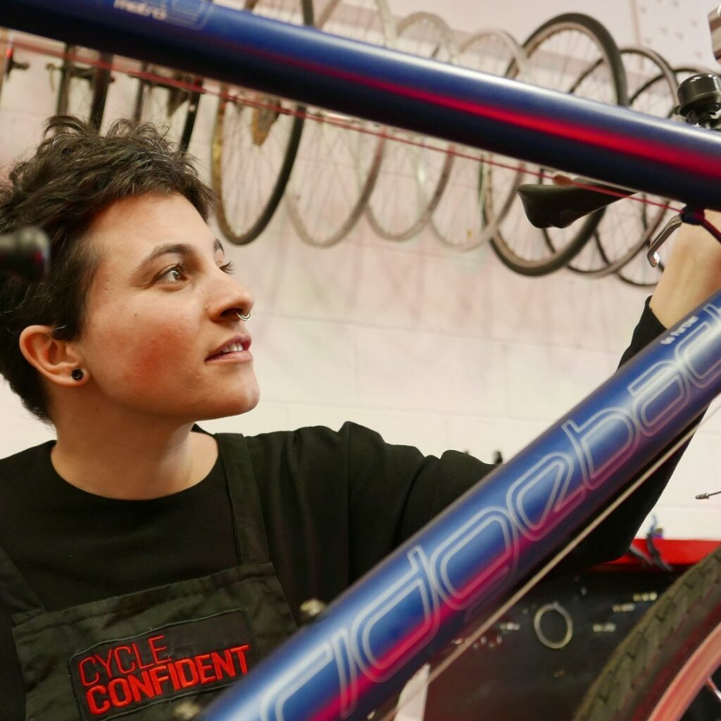young person fixing a bike